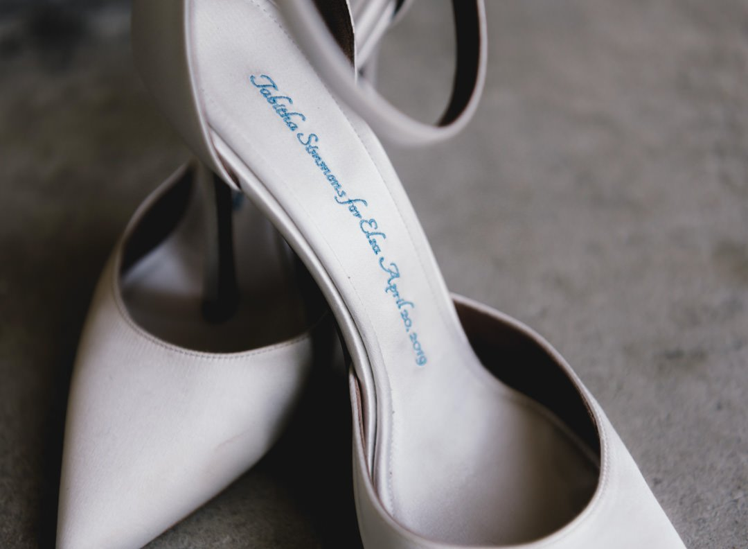 tabitha simmonds shoes embroidred with the brides name in blue