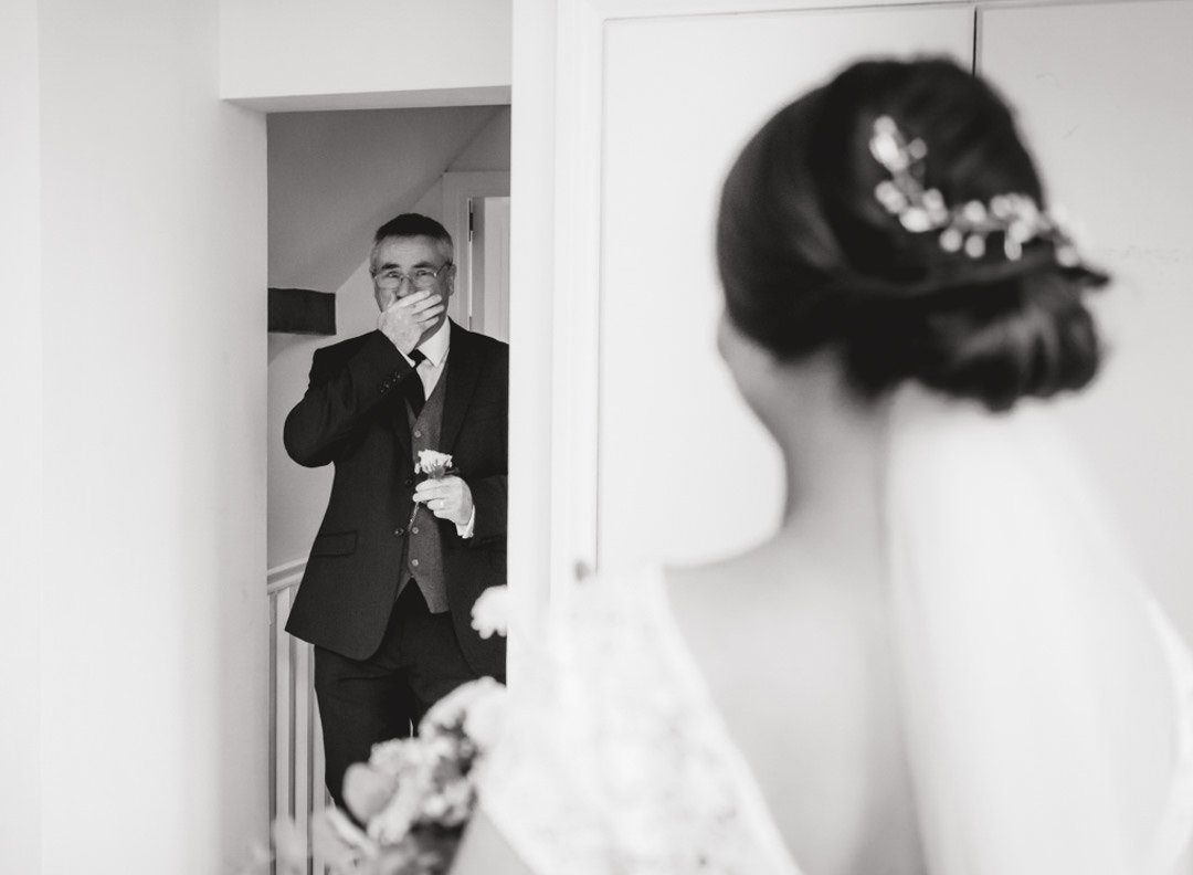 father of the bride weeping as he sees his daughter ready to get married