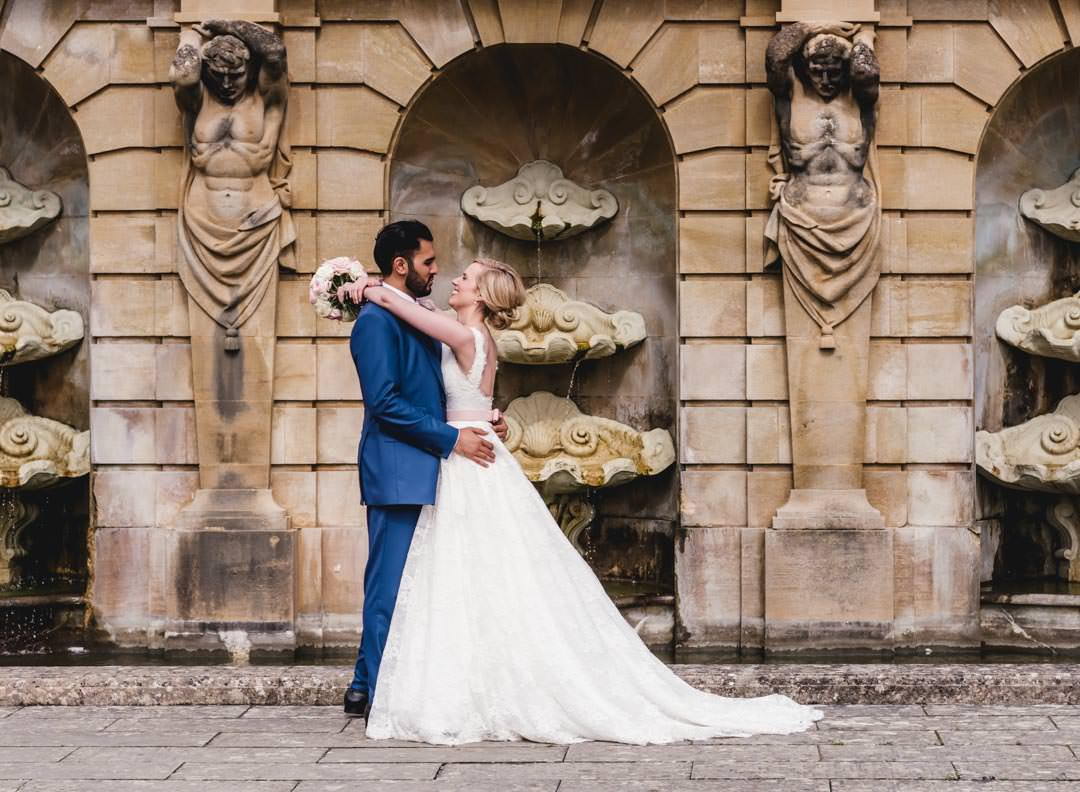 bride and groom embracing in the italian water gardens at blenheim palace